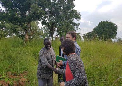 Amani and partners visiting Mucwini massacre site